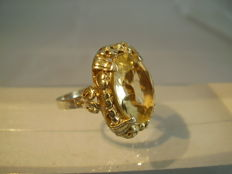 Antique silver ring with large, orval facetted citrine of 15 ct.