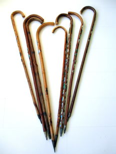 Eight hunting sticks with approximately 60 emblems, including England, Scotland, Germany, Switzerland and the Netherlands