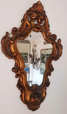 Beautiful baroque-style mirror with plaster frame and gilding