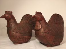 Two big old solid wooden chickens