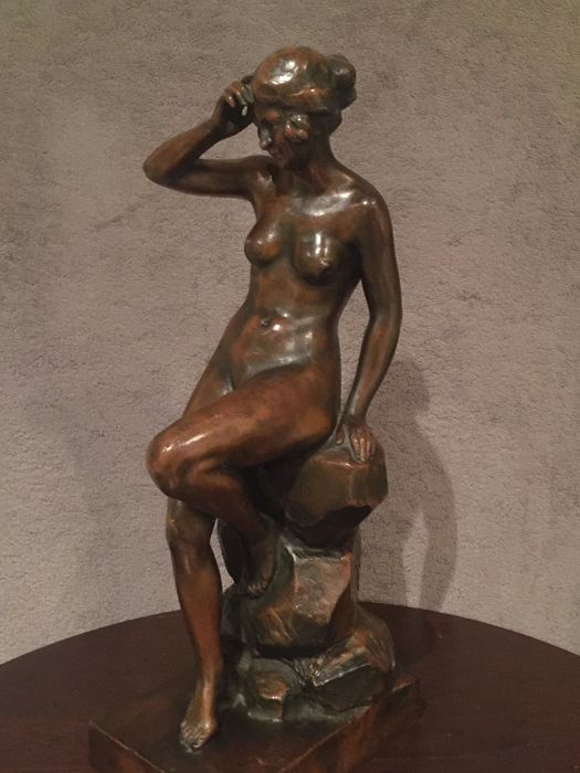 L. Malsert - naked woman sitting on a rock - bronze sculpture