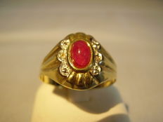 14 kt gold ring with oval, natural ruby (1 ct) and diamond florets (0.02 ct)