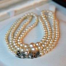 Antique two strands necklace with salt water pearls and 18kt. white gold Art Deco clasp with 4 old cut diamonds, ca. 1920