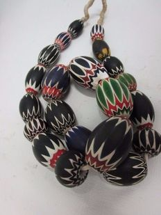 Necklace of beads entirely made of chevron from different eras