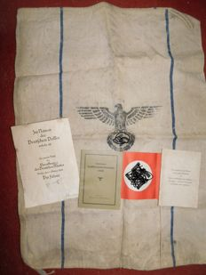 Original certificate for the mother cross, food bag and paper flag, World War II