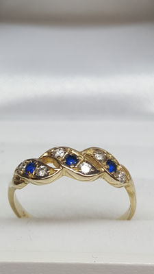 14 kt yellow gold ring set with zirconias and sapphires, size 17.5