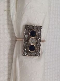 Antique rectangular ring with 2 small sapphires, rosette diamonds and shards.