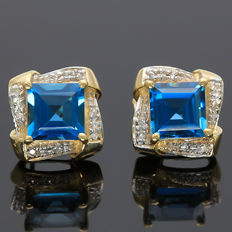 4.3 cts London Blue Topaz and 0.07 ct Round Cut Diamond in 14K Gold Stud Earrings - Size 11.43 x 11.43 mm (No reserve price)