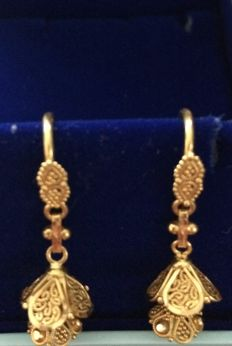 Playful golden Indian earrings