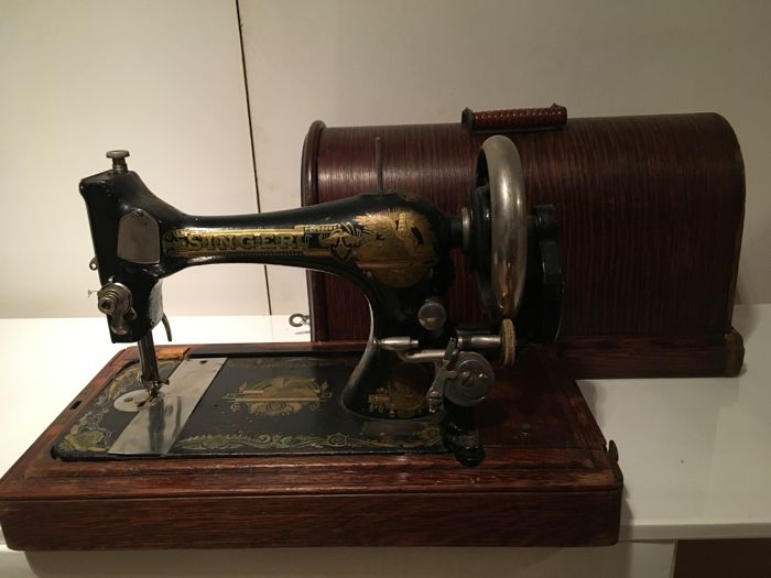 Magnificent antique Singer sewing machine with a dust cover and key, 1891