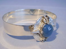 Signed designer bangle with light blue chalcedony from the 50s