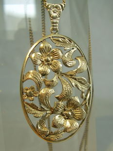 Antique pendant, handmade with hand-engraved blossoms and leaves