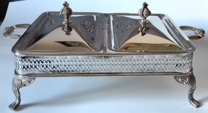 A silver plated open work serving tray with 2 covers on four feet