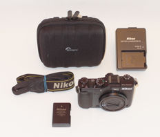 Nikon COOLPIX P7000 digital high-end camera: NIKKOR wide-angle lens with 7.1 x zoom, large CCD image sensor, HD film shooting: Lowepro bag