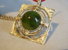 Designer pendant with forest green jade/nephrite cabochon of 10 ct on a long necklace