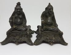 Sculpture; Set of 2 Buddha statues with 'surprise for voyeurs' - ca 1900