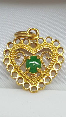 999 kt yellow gold women's pendant set with emerald