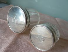 Two bottles or jars in hand cut crystal and lid, punched monogram in silver