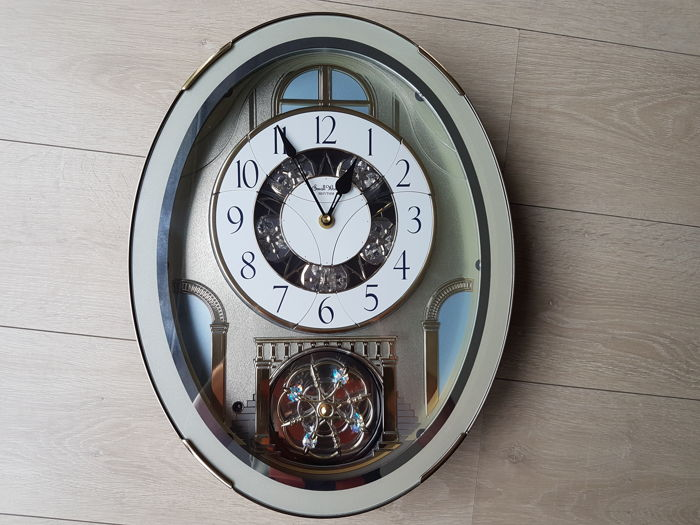 "Rhythm Clock Classic Brilliance Melodies Wall Clock 4MH787PD18 - Rotating Wheel - List ""B"" Christmas Melodies"