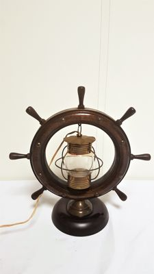Table lamp in the form of a ship steering wheel.