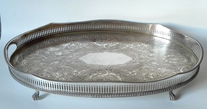 An open work silver plated serving tray with floral engravings on four feet - SHEFFIELD ENGLAND