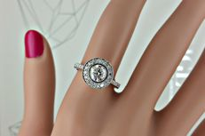 1.14 ct E/VS1  round diamond ring made of 14 kt gold - size 7