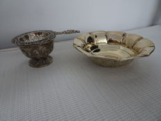 3 pieces of Dutch silverware, including a tea strainer, a drip tray and a dish
