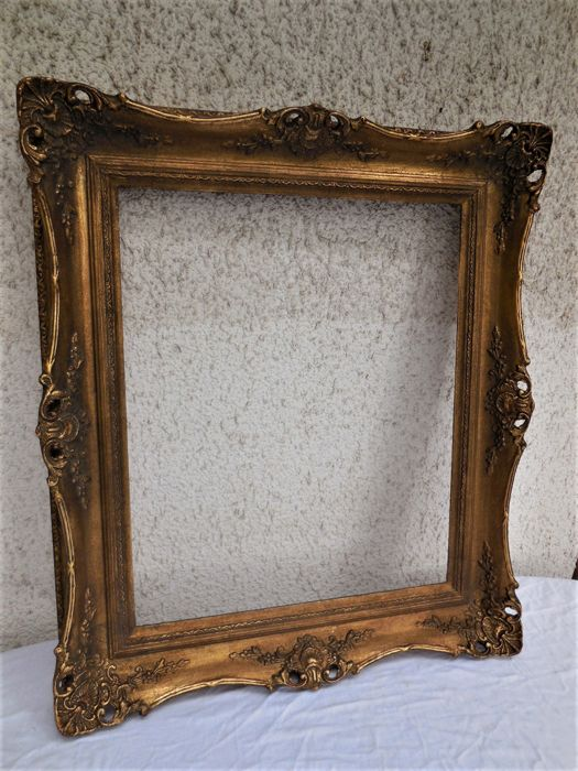 Large old wood frame with carving/moulding and gilding, country of ...