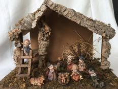Beautiful complete distinctive nativity scene with cute figures including Jesus with a halo of Swarovski crystals