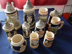 Collection of 11 beer steins in various sizes
