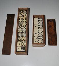 Professional, comprehensive domino game, 55 pieces and game with 28 pieces, bone on ebony, approx. 1910.