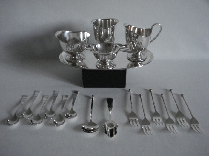 Silver plated items:  Herbert Hooijkaas (HH):  Cream set with spoon vase and tea strainers, Empire style. Spoons and Sugar spoons, Biedermeier & Empire. Forks, with twisted hilt and knob.
