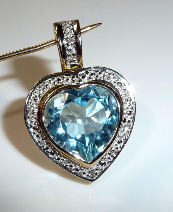 Clip-on pendant made of 14 kt/585 gold, heart with 2.7 ct blue topaz + 12 diamonds **no reserve price**