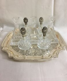 A dressing table set consisting of 7 crystal dressing table bottles, some with silver-plated caps, on silver-plated tray