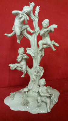 Porcelain Cupids Sitting above a Tree
