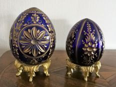 Fabergé: Two hand-cut eggs in cobalt blue with gold decorations.
