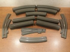 Märklin H0 - 24130/188/224/230/611/671/672 - 41-piece collection of C-rail, including (curved) switches, straight and curved railway pieces