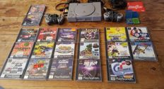 Playstation 1 including 2 controllers , 2 memory card and 20 Games