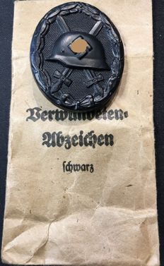 3. WW 2. World war wounded badge in black 1939 including bestowal bag