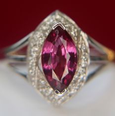 0.74ct ring with a Rhodolite flanked by 36 point Diamonds. [I/VS2] in white 9Kt.gold - excellent condition - no reserve