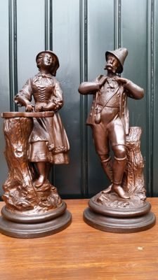 Two bronze coloured terracotta sculptures - Hunting depictions