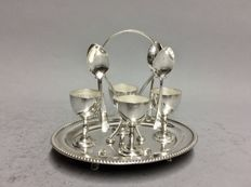 Four silver plated egg cups and spoons in an oval silver plated mounting, Sheffield, England, ca. 1910
