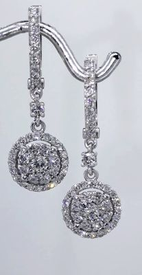 14 kt White gold stud earrings set with diamonds, 1.25 ct in total.
