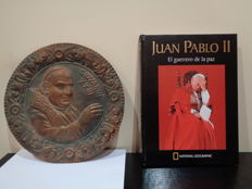 Brass dish with the image of the Roman Pope Giovanni XXIII and book 'Juan Pablo II'. El Guerrero de la paz  (The warrior of peace.)