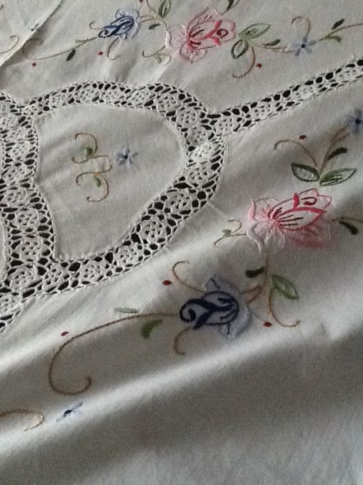 Hand-embroidered tablecloth with crochet inserts