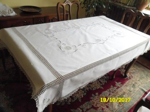 A large hand embroidered tablecloth with crocheted lace. 1980s
