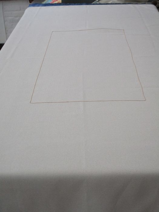 Tablecloth of beige toile with fantasy ribbon garnished