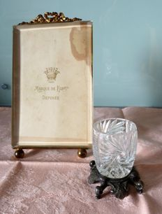 Set of two charming objects, one frame in glass and gilded bronze and one small crystal vase mounted on heavy metal