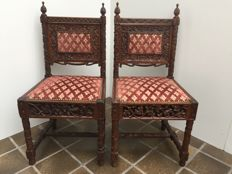 A pair of richly carved oak chairs - France - c. 1840