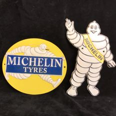 Two Michelin man Plaques; standing and smoking Bibendum in cast iron
